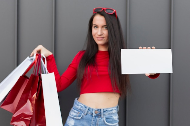 Client in red shirt holding copy space banner Free Photo