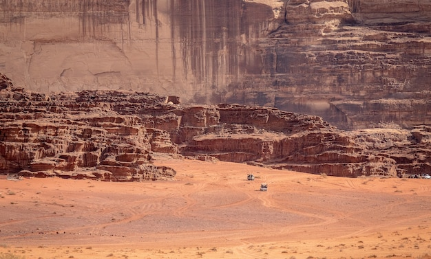 Cliffs and caves on a desert under the sunlight at daytime Free Photo