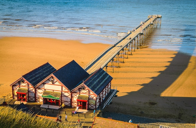 Clifftop view of pier at saltburn by the sea Premium Photo