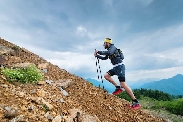 Climb a mountain with sticks Premium Photo
