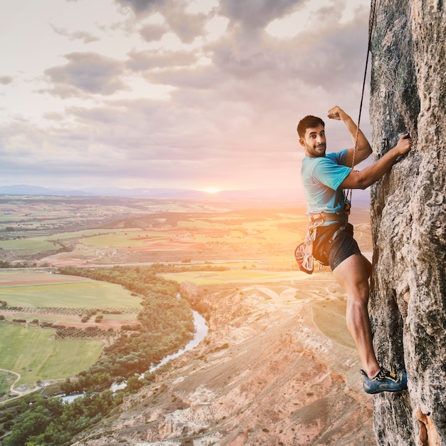 Climber on wall with landscape Free Photo