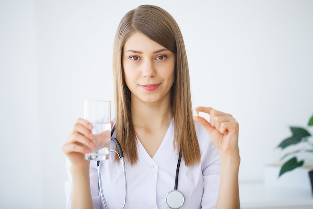 Clinic. portrait of young doctor standing in medical office Premium Photo