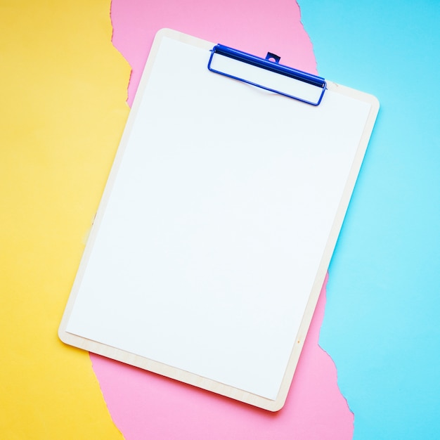 Clipboard on paper background Premium Photo