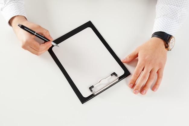 Clipboard on a white table Premium Photo