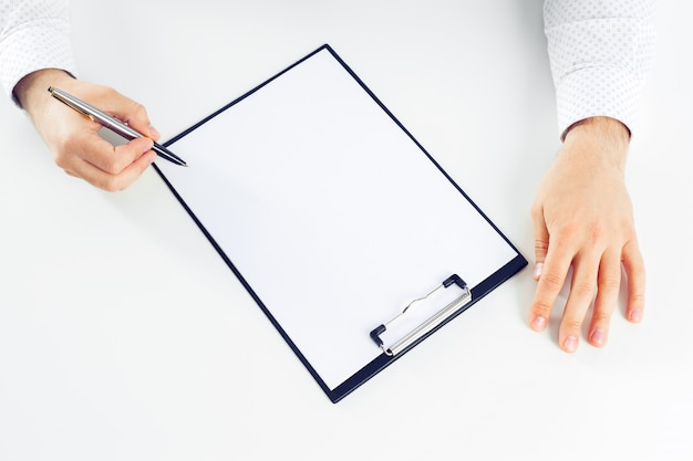 Clipboard on a white table Premium Photo