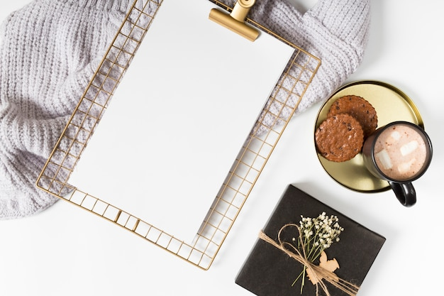 Clipboard with coffee cup and cookies  Free Photo
