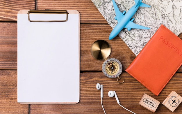 Clipboard with compass and passport on the table Free Photo