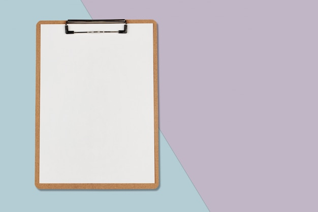 Clipboard with white sheet on pastel color background, minimal concept Premium Photo
