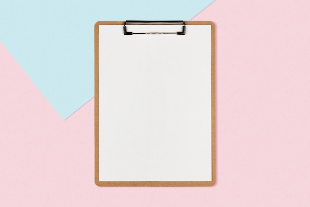 Clipboard with white sheet on pastel color background Premium Photo
