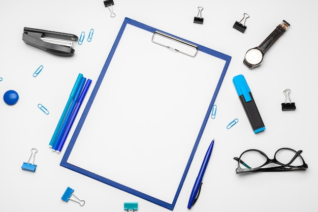 Clipboard with white sheet and pen on a white background Premium Photo