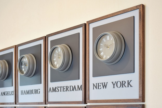 Clock different time zones on the wall Premium Photo