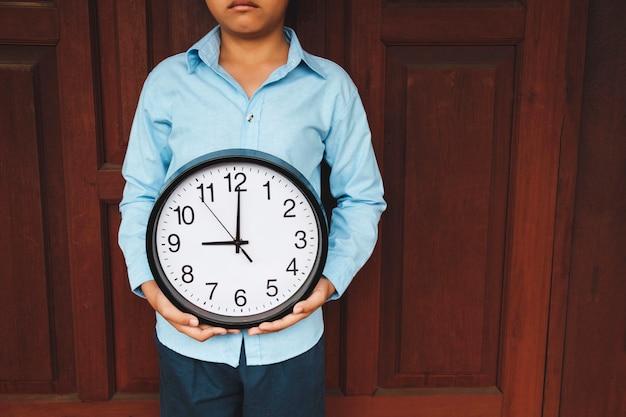 Clock in hand, concept of time Premium Photo