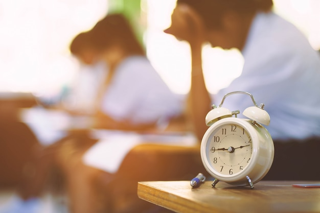 The clock is used to see the time students take exam in the classroom. Premium Photo