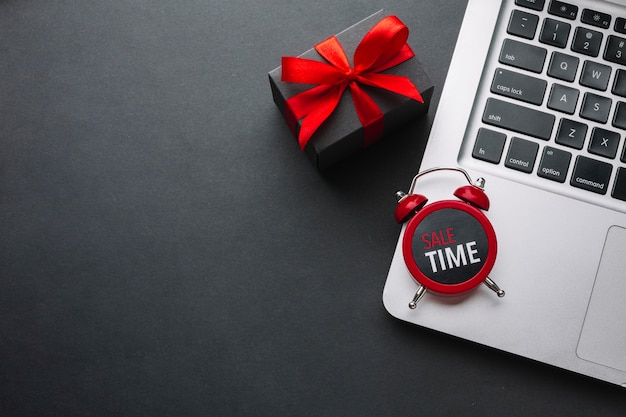 Clock on laptop with copy space Free Photo