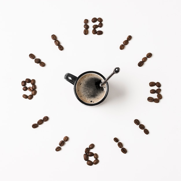 Clock made from coffee beans and mug Free Photo