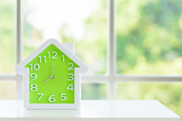 The clock model with 8 a.m. and window in the morning. Premium Photo