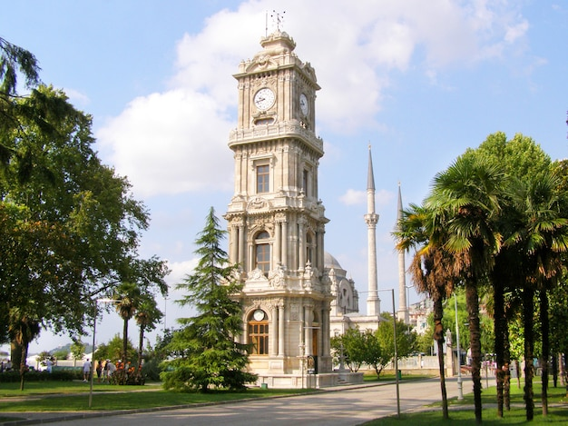 Clock tower on the territory of the dolmabahce palace in istanbul. Premium Photo