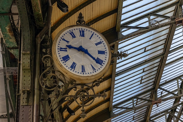 Clock at a traditional train station in paris, france Premium Photo