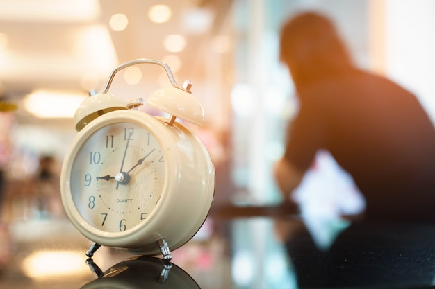 Premium Photo | Clock of waiting with woman