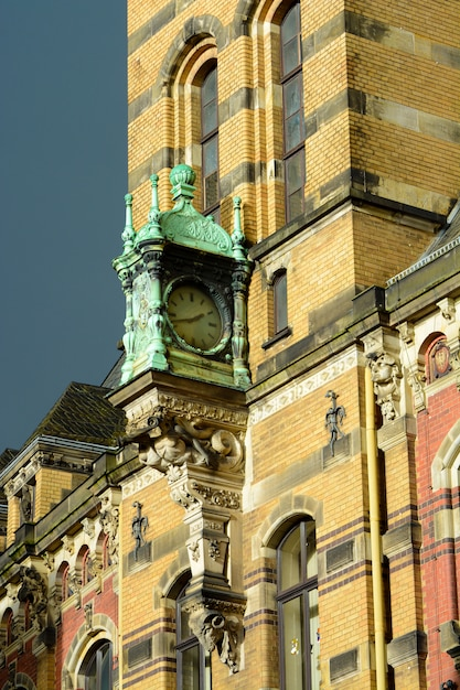 Clock on the wall of a house in the old district of bremen, germany Premium Photo