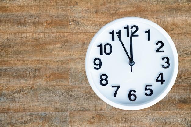 Clock on wood background Free Photo