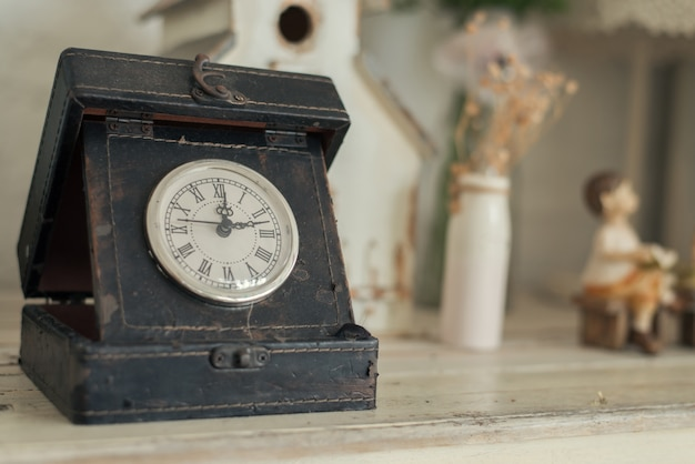 Clock on a wooden background. Free Photo
