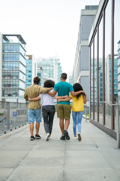 Close friends walking around city together Free Photo