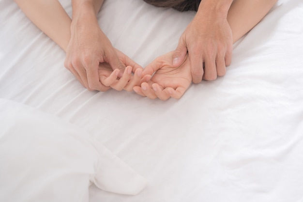 Close hands couple having sex on bed Premium Photo