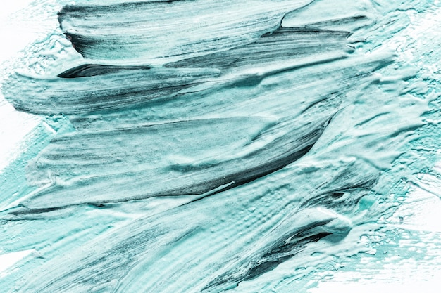 Close-up of abstract blue paint brush strokes on surface Free Photo