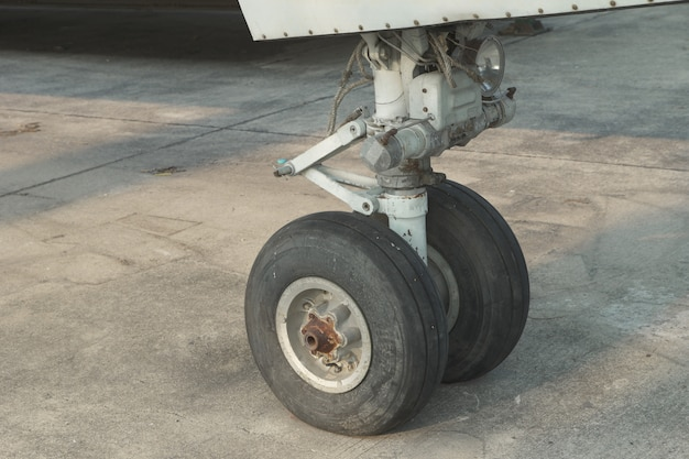 Close up on an airplane front wheel Premium Photo