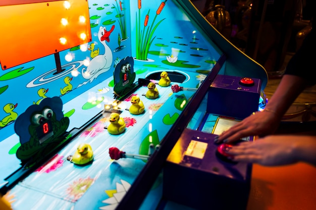 Close-up arcade game with rubber ducks Free Photo