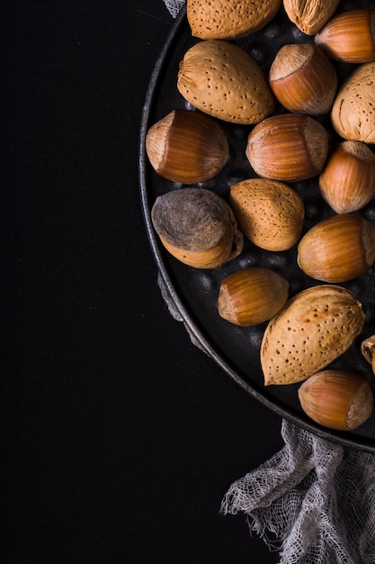 Close-up arrangement of fresh nuts Free Photo