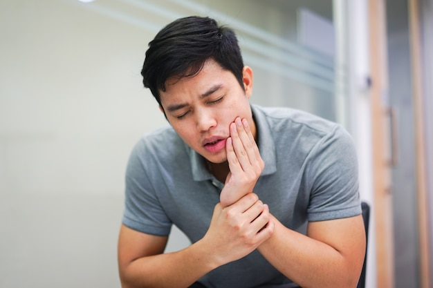 Close up asian man feeling pain from toothache , dental concept Premium Photo