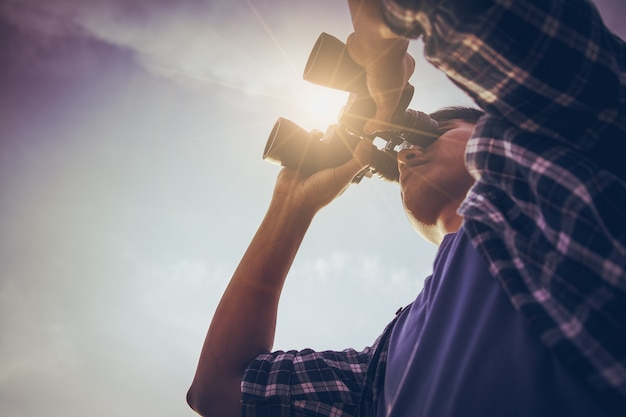 Close-up of asian man hand using binoculars Premium Photo