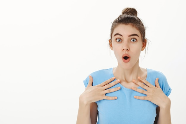 Close-up of attractive surprised woman getting to know she won prize Free Photo