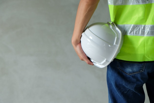 Close up back view of builder, engineer, worker wear the safety vest Premium Photo
