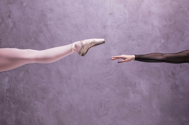Close up ballerina leg and arm Free Photo