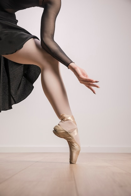 Close up ballerina in pointe shoes Free Photo