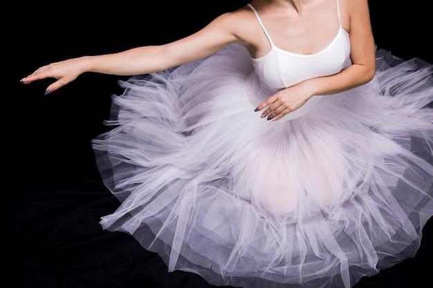 Close up ballerina sitting in dress Free Photo