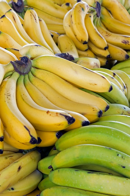 Close-up of banana bunch on street market stall Premium Photo