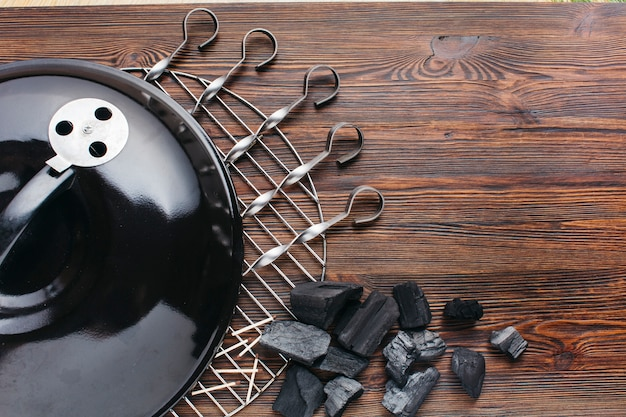 Close-up of barbecue appliance with skewer and coal Free Photo