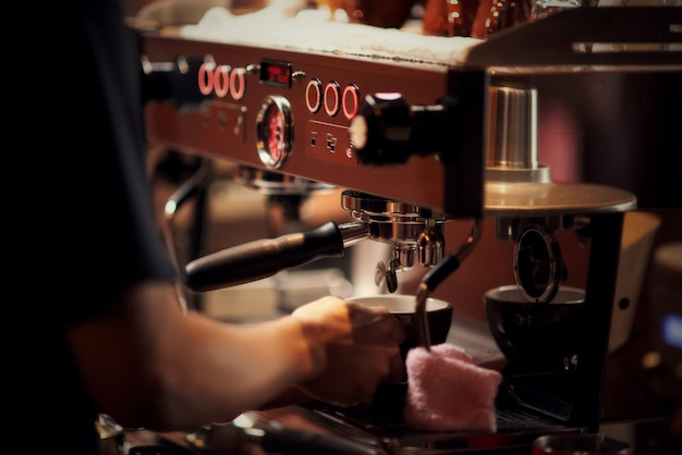 Close up barista making cappuccino, bartender preparing coffee drink Free Photo