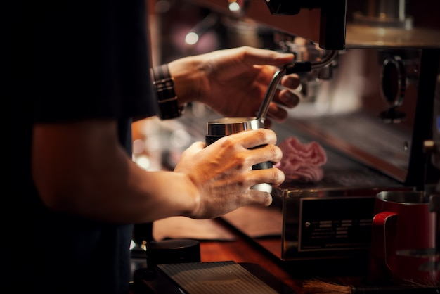 Close up barista making cappuccino, bartender preparing coffee drink Free Photo