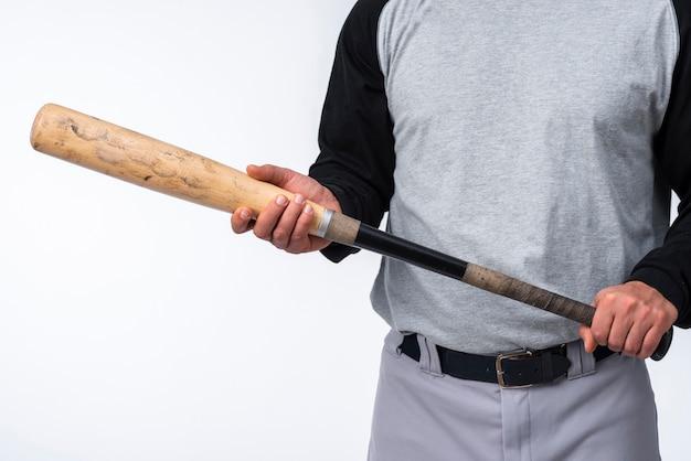 Close-up of baseball player holding bat Free Photo