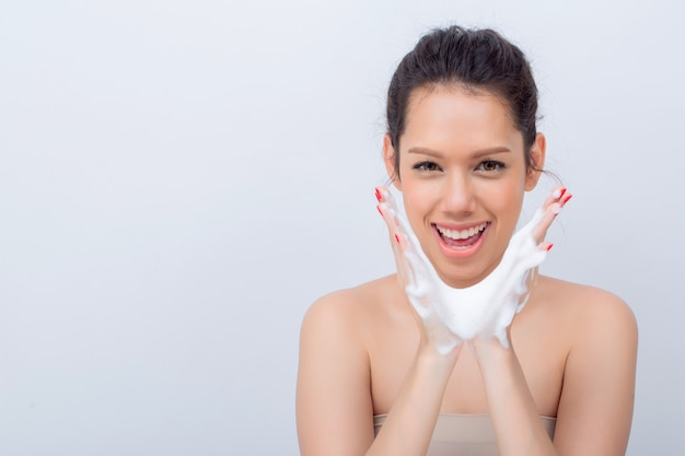 Close up of beautiful asian woman v-shape face with cleansing foam for skin care Premium Photo