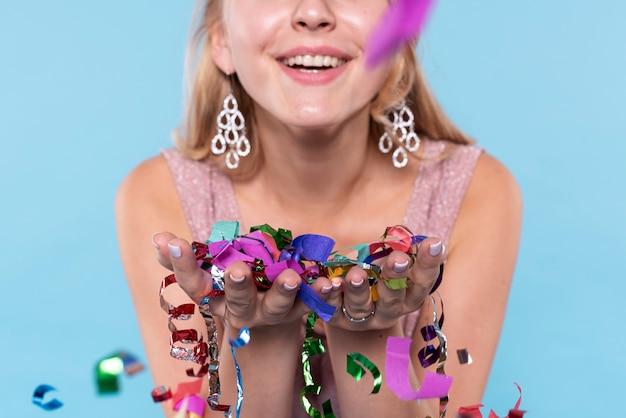 Close-up beautiful woman holding confetti Free Photo