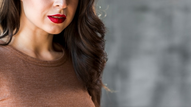 Close-up of a beautiful young woman with red lips Free Photo