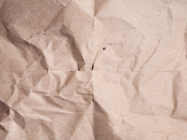 Close-up beige crumpled paper background Free Photo
