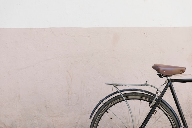 Close-up of a bicycle in front of painted wall Free Photo