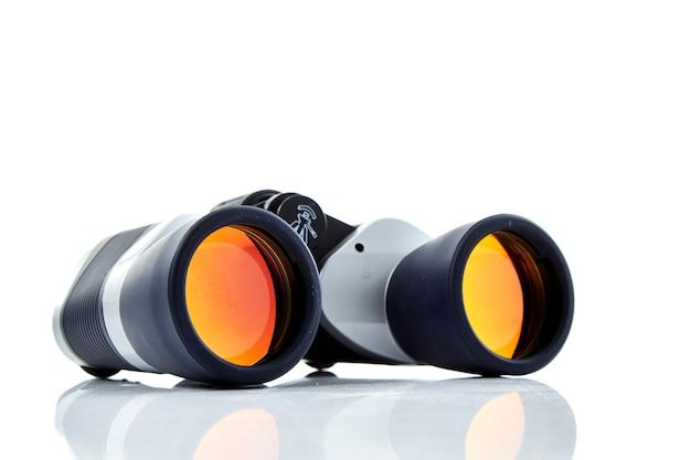 Close-up of binoculars  white background Premium Photo